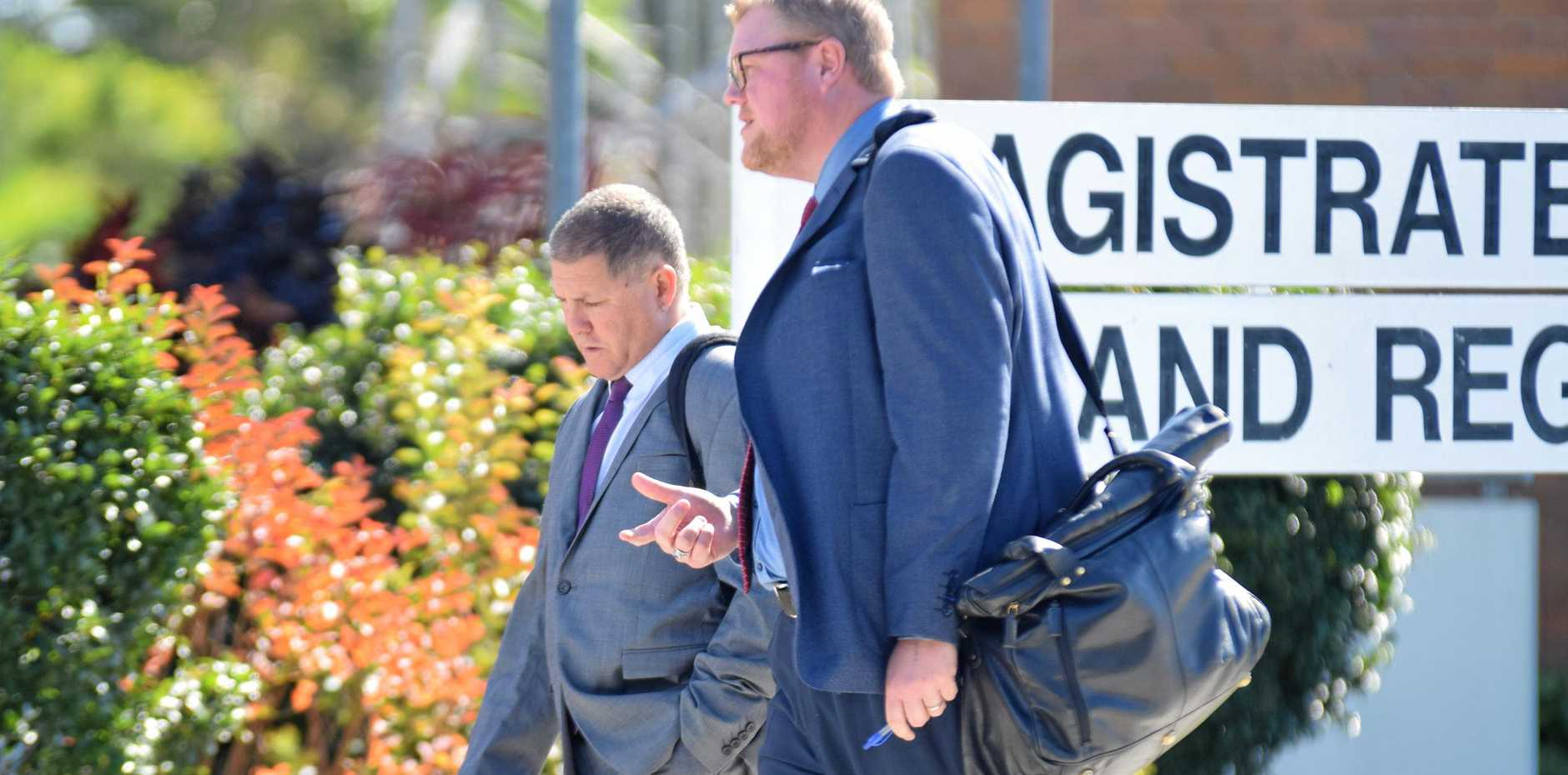 CONVICTED: Douglas John Wieland (left) and solicitor Chris Anderson leave Gympie Magistrates Court yesterday.