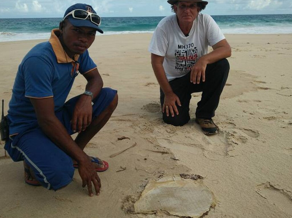 Blaine Gibson and helper Cyriak with a piece of possible MH370 debris in Madagascar. Picture: Facebook