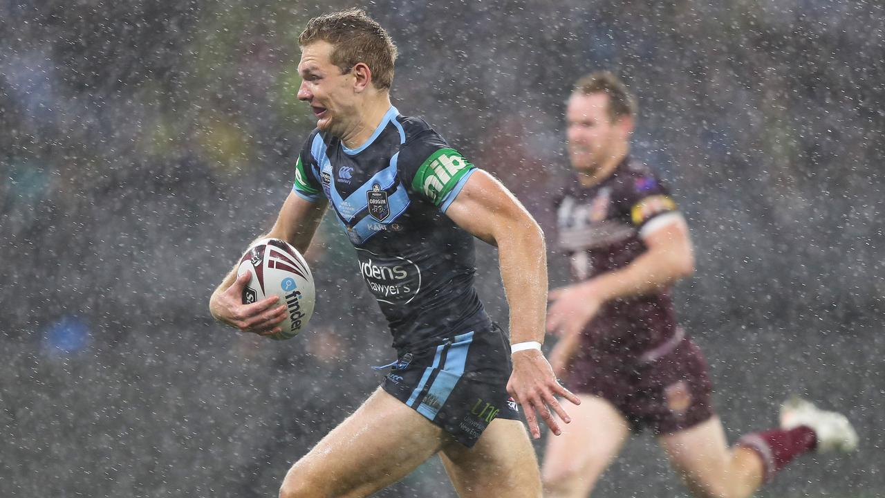 Tom Trbojevic races in to score one of his three tries in Origin II.