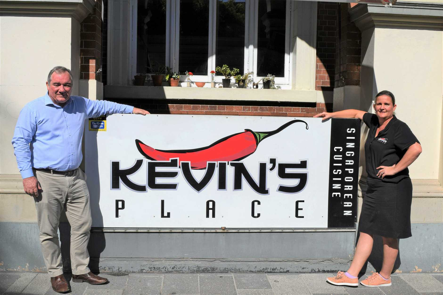 Knight Frank marketing agent Mark Kelly with owner of Kevin's Place Kelly Ah Wang. The restaurant is up for lease.
