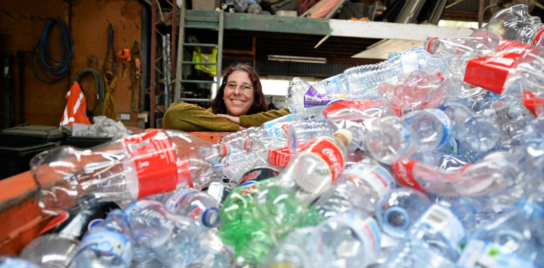 MILLIONS: Container for Change scheme accounts manager Amanda McCasker with just some of the bottles donated each week in Central Queensland.