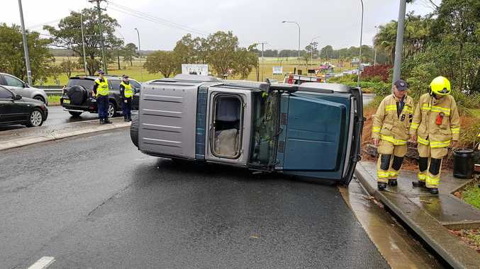Woman hospitalised after car rollover at roundabout