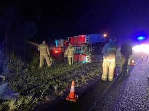 Fire truck flips on its side on way to a job