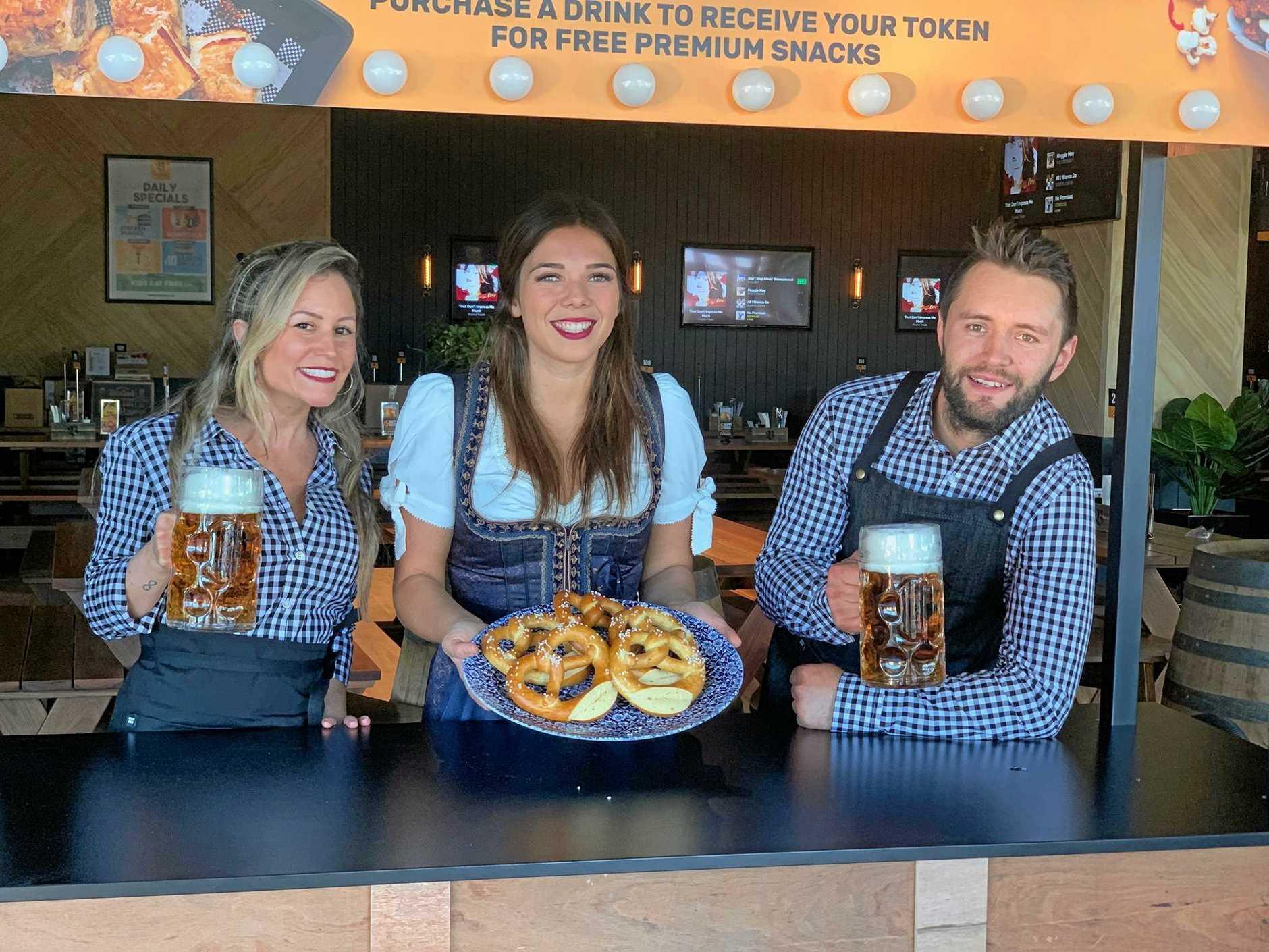 Bavarian waitress Mariana Oman, assistant restaurant manager Elisabeth Weichel and bartender Daniel Edgar.
