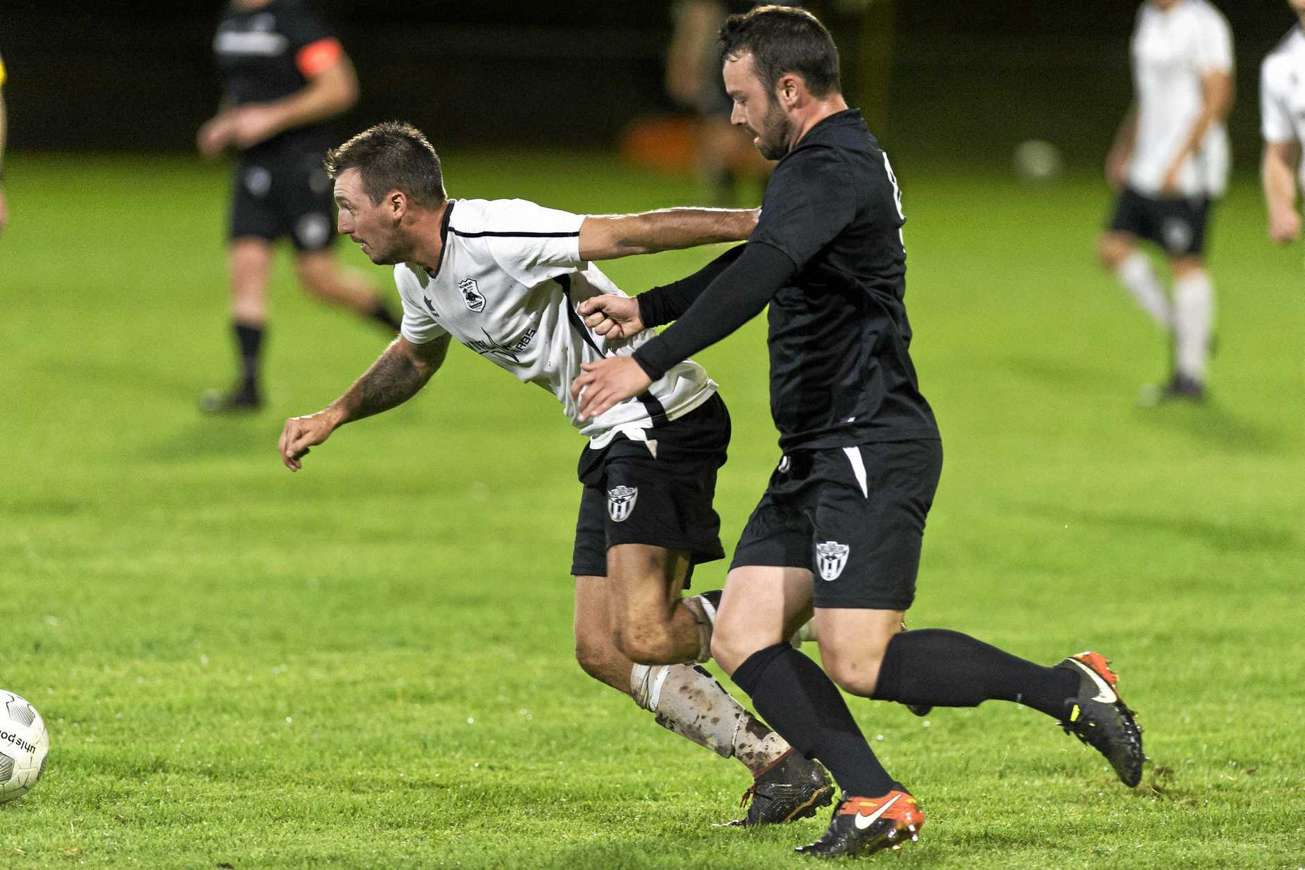 Willowburn FC's Brodie Welch (left) edges past Willowburn White opponent Nick McGauley. Welch scored four goals in his side's win over Highfields at the weekend.