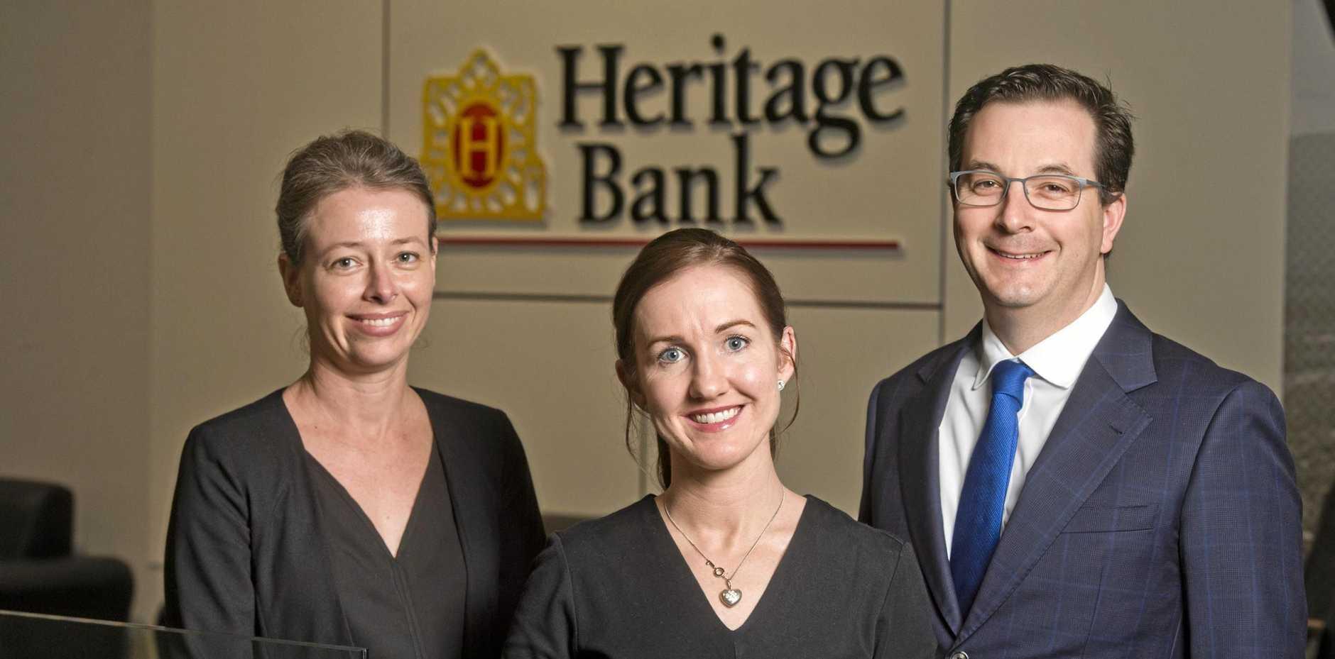 EXECUTIVES: Enjoying life at Heritage Bank are (from left) Alyssa Egerton, Bernadette Murphy and Dan Dredge.