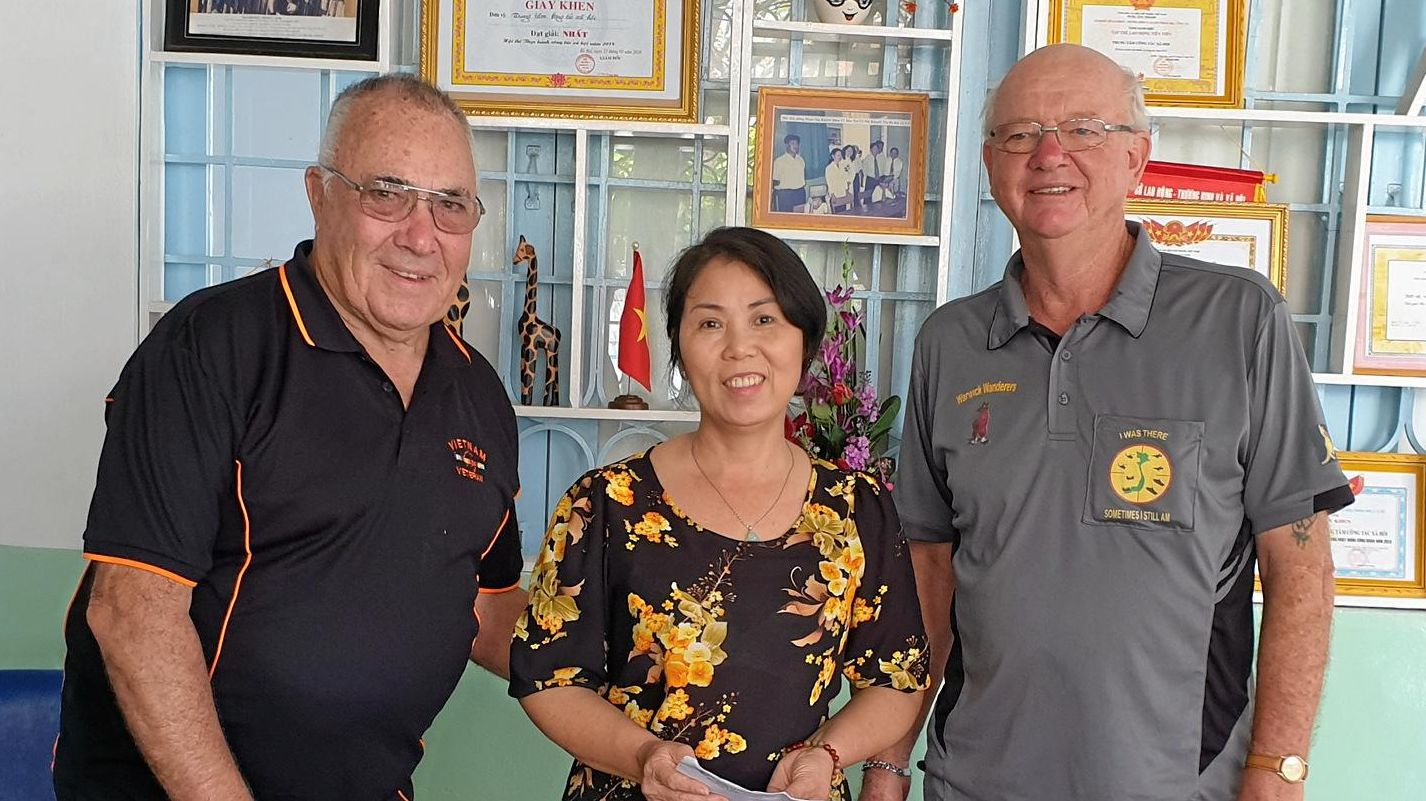 RETURN TRIP: Vietnam veterans Barry Kelly (left) and Terry Smart (right) recently travelled to Ba Ria Orphanage after raising $3435 to donate. Pictured here with director Nguyen Thi Lien.