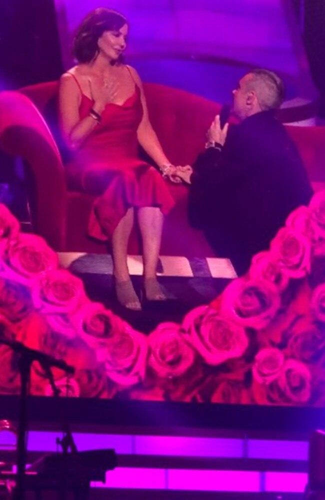 Adelaide's Kelli Foran being serenaded by Robbie Williams in Las Vegas. Picture: Supplied