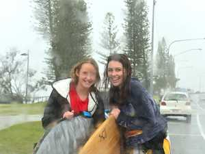 Maddy Long and Shelly Baker getting drenched at
