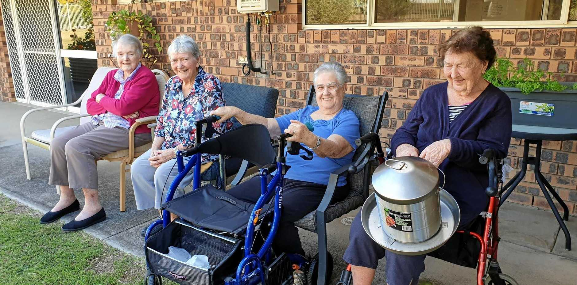 Ridgehaven residents Kath Booth, Mary Collingswood, Doris Gull and Rita Harvey getting ready to feed the new chickens.