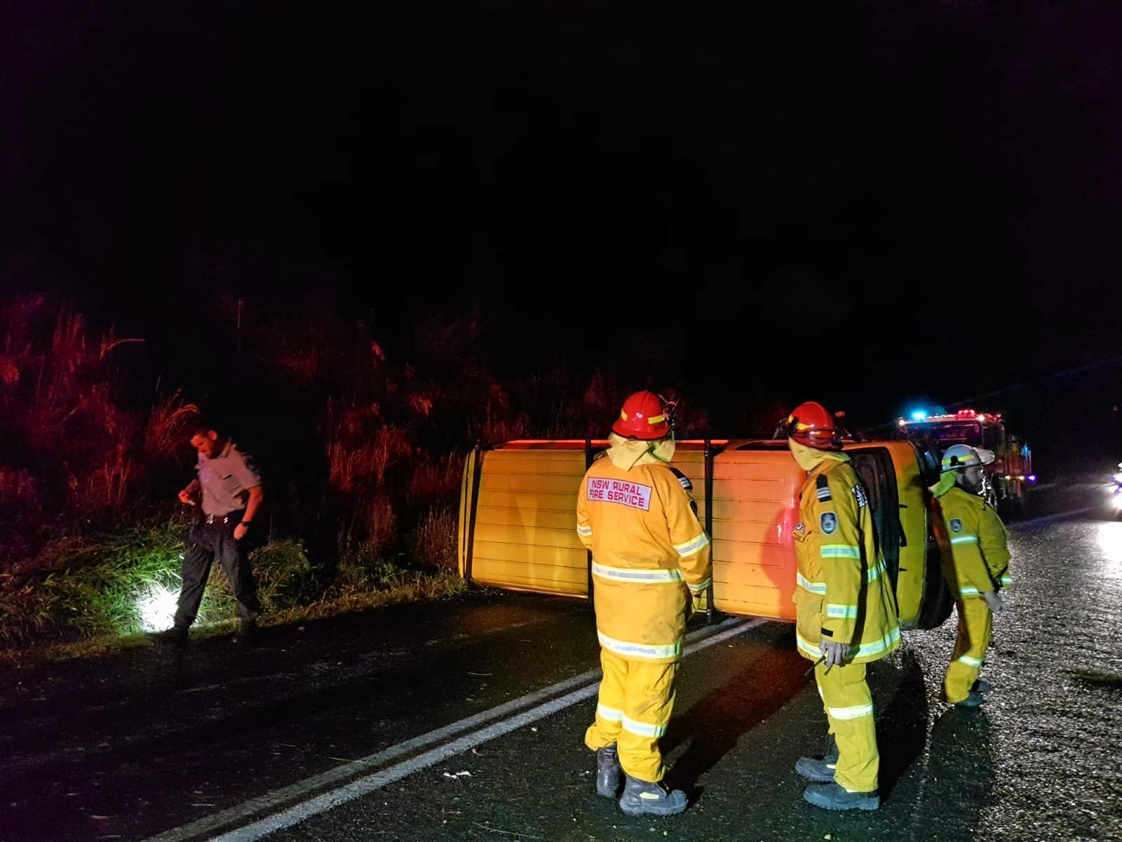 LUCKY ESCAPE: The driver of this Toyota Hiace walked out with no visible signs of injury after rolling the van near Coramba on Tuesday night.