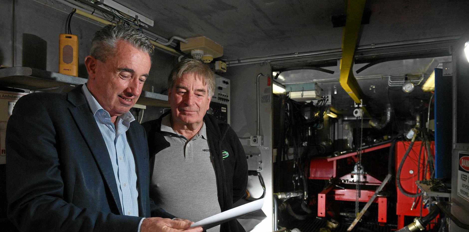 MP Kevin Hogan with HRDS Technologies co-owner Trevor Dunn where the company will test its revolutionary device that reduces greenhouse gases produced by heavy vehicles.