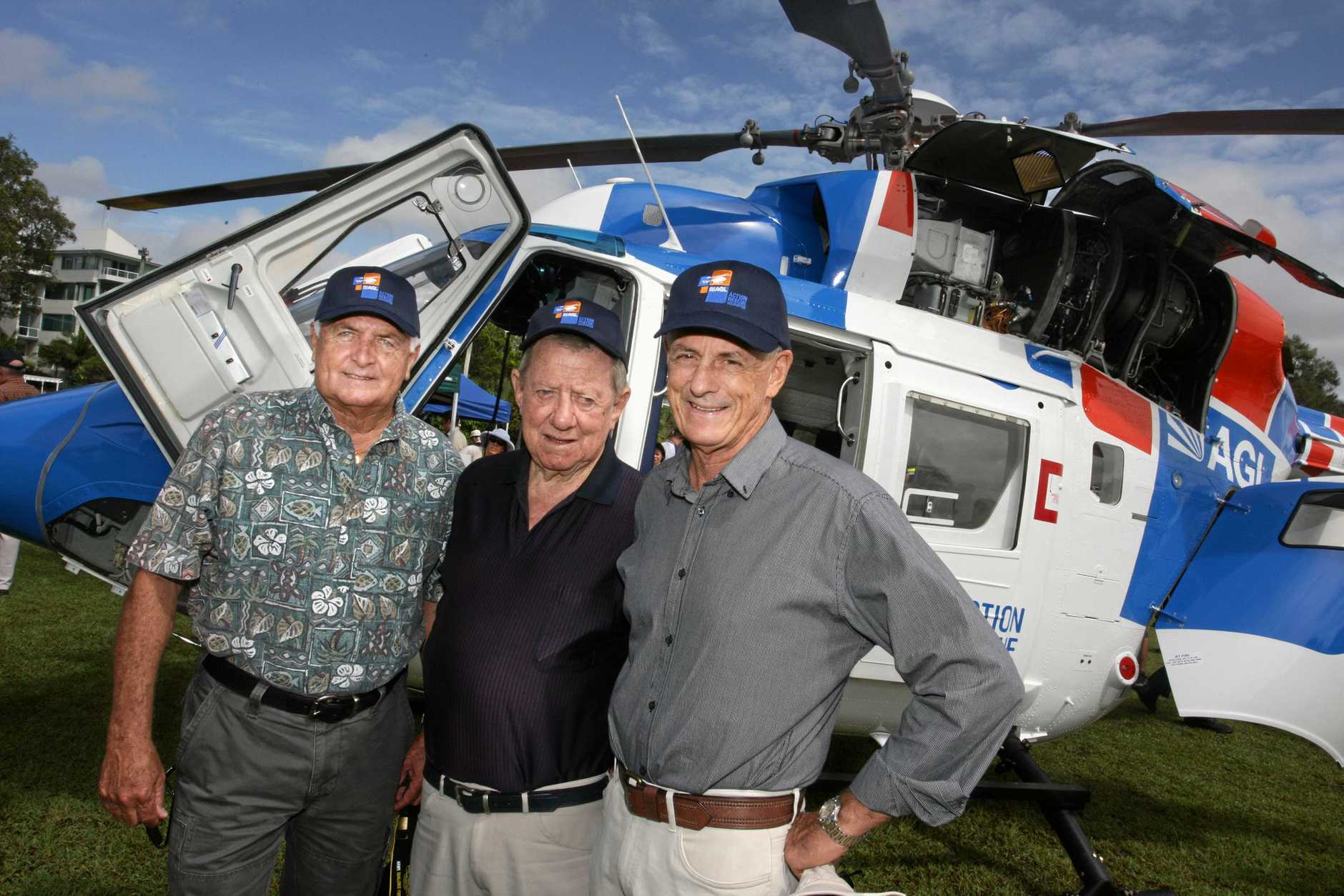 Foundation members Hayden Kenny, Roy Thompson, and Jim Campbell at the unveiling of the AGL Action Rescue helicopter at Cotton Tree Park.