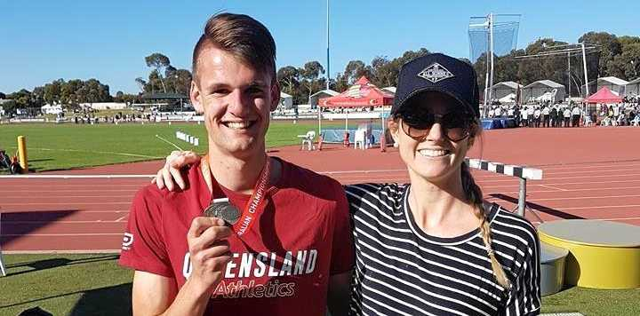 GOLD: Justyn Rogers alongside coach Bec Rogers after one of his successful competitions.