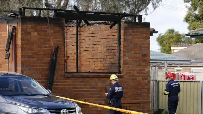 Investigators are seen at the site of a fatal house fire. Picture: AAP Image/Darren Pateman Source: AAP