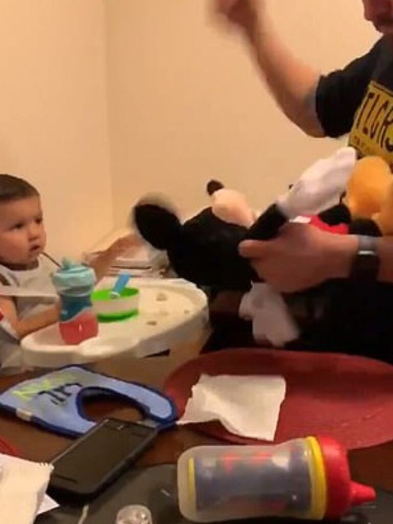In the 'disturbing' footage, the dad bashes a mickey mouse toy. Picture: Twitter