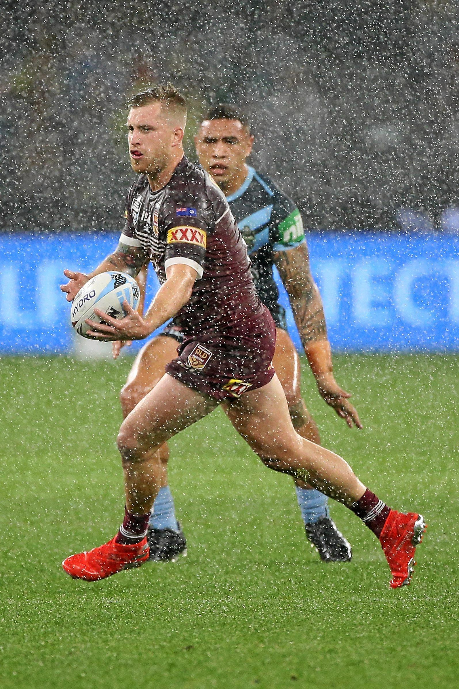 PERTH, AUSTRALIA - JUNE 23: Cameron Munster of Queensland looks to pass the ball during game two of the 2019 State of Origin series between the New South Wales Blues and the Queensland Maroons at Optus Stadium on June 23, 2019 in Perth, Australia. (Photo by Paul Kane/Getty Images)