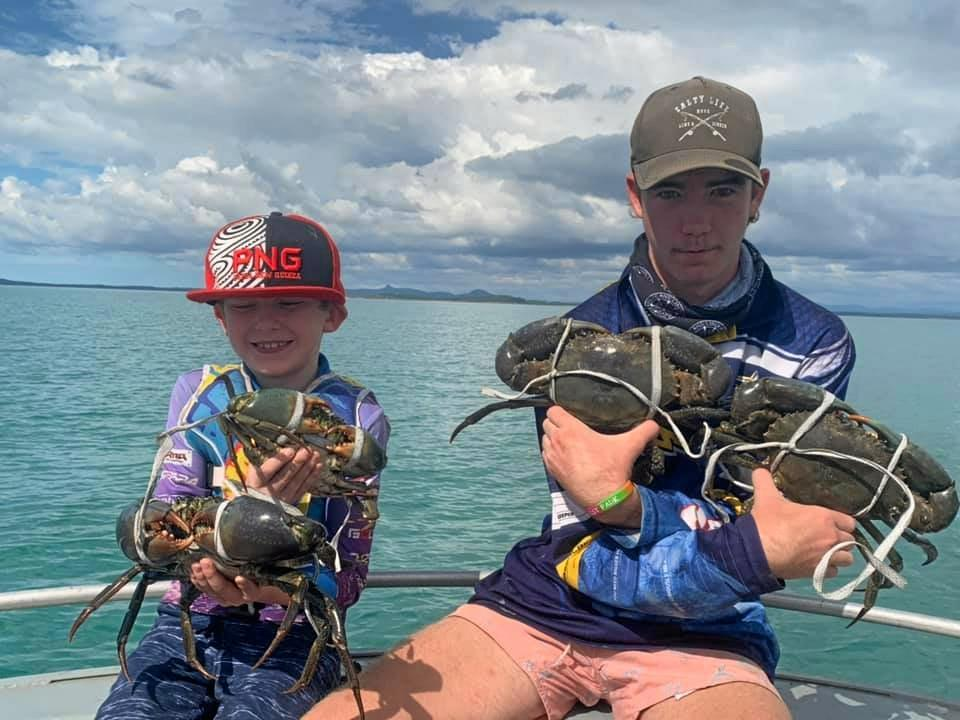 Ronan Miosge, 8 and Boyce Miosge, 15 with mud crabs caught in Coconut Creek.