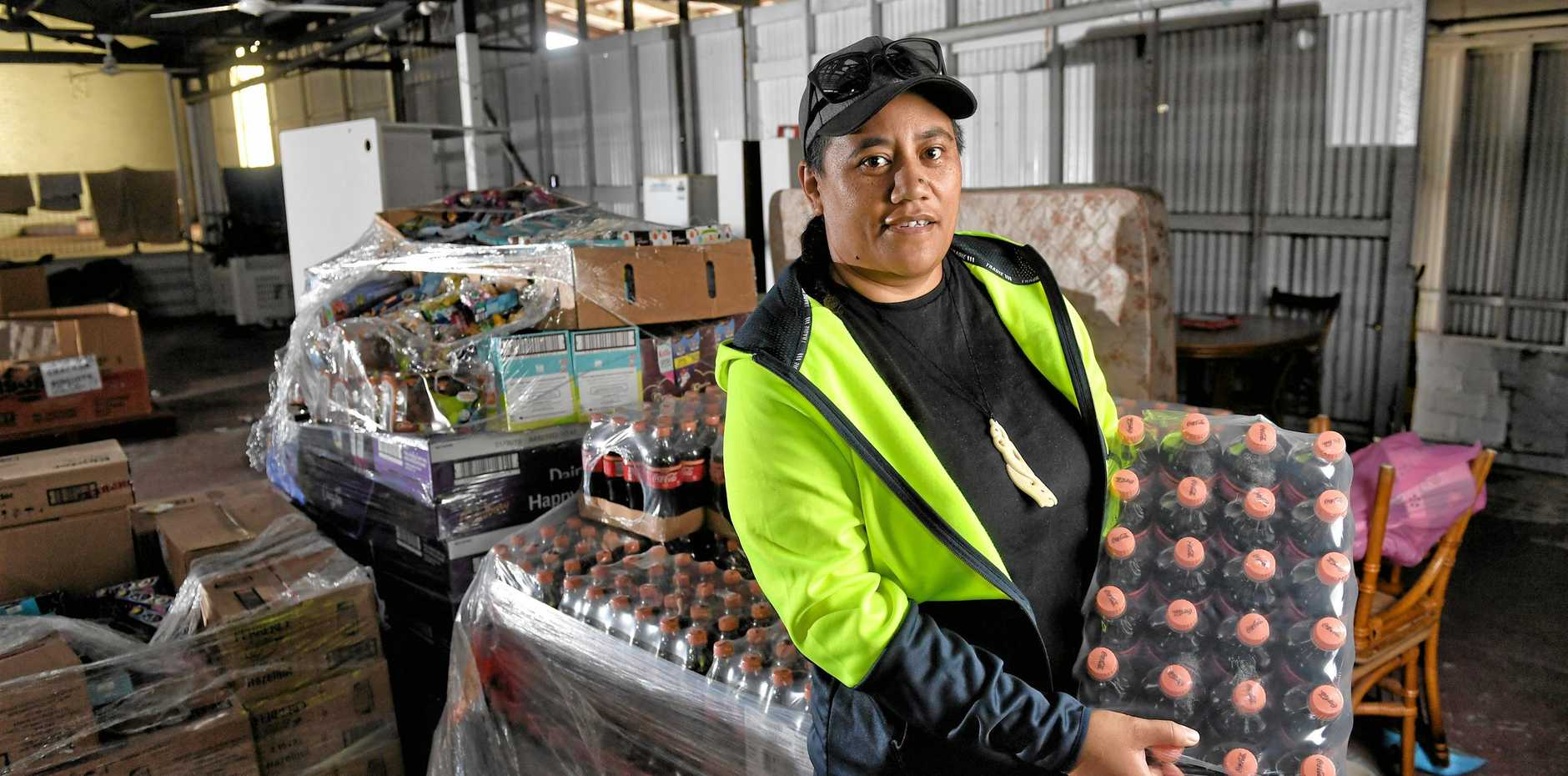 Ipswich Food Barn managing director Qim Kauwhata with donations from Costco.