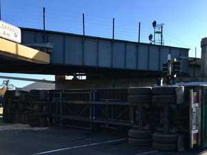 Truck flip closes roads, causing major delays