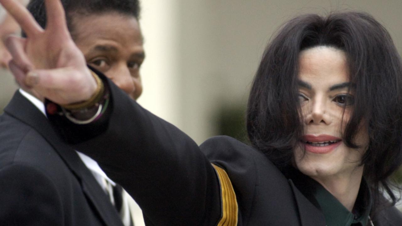 Jackson waved to his supporters at his child molestation trial in 2005. Picture: AP Photo/Michael A. Mariant