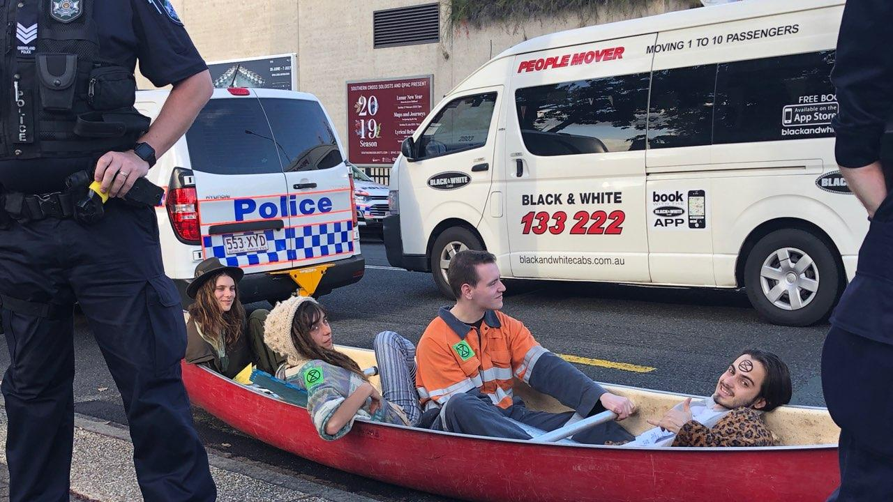 Four activists have locked themselves onto the canoe using metal pipes, meaning they will be unable to be removed without being cut out. Picture: Andrea Macleod