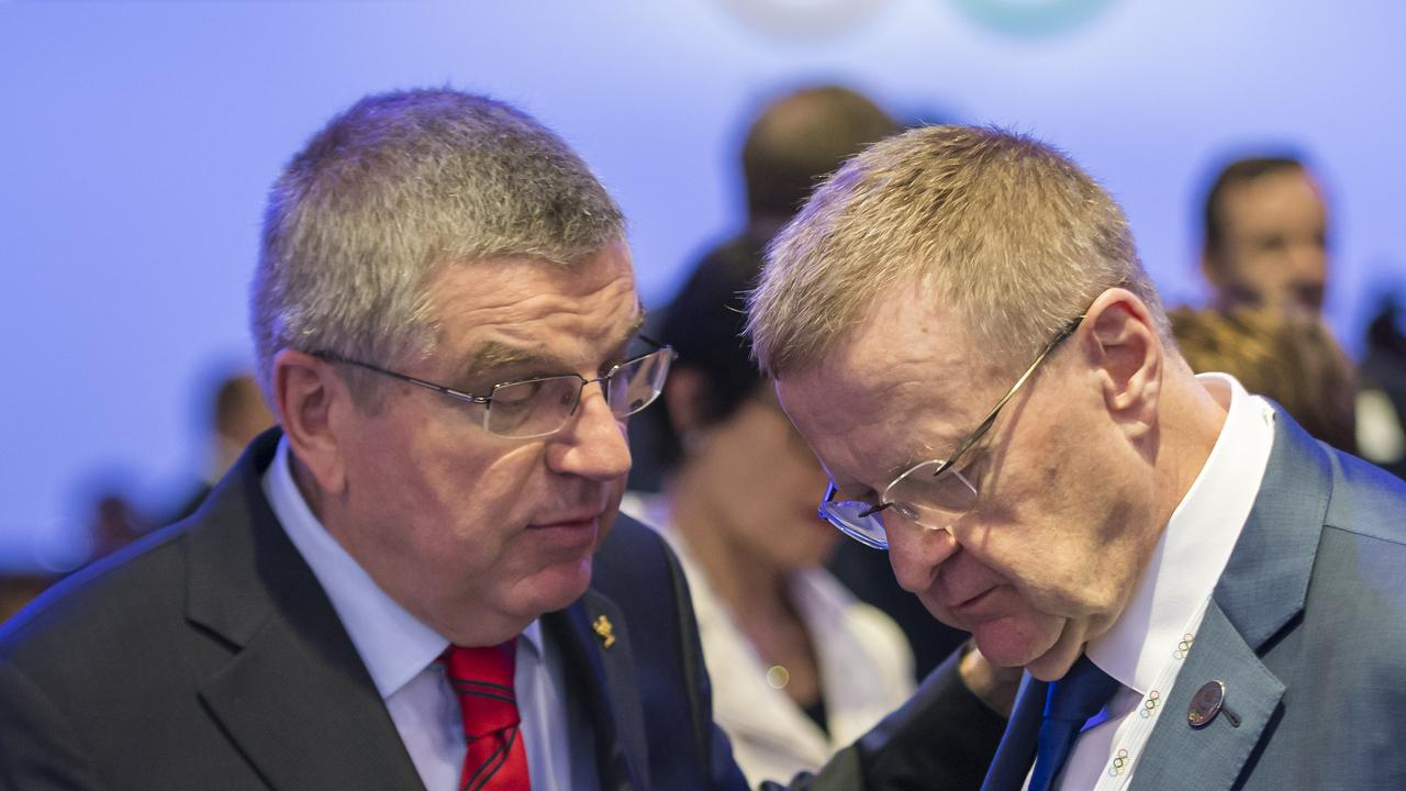International Olympic Committee President Thomas Bach from Germany (left) speaks with Australian IOC member John Coates. Picture: AP/Jean-Christophe Bott/Keystone.