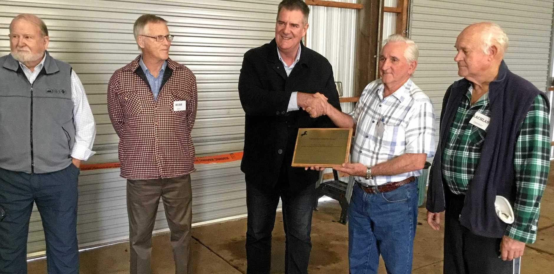 NEW HOME: Agricultural Industry Development and Fisheries minister Mark Furner congratulates the Yarraman Men's Shed members on their new location, the Mill St Workshop.