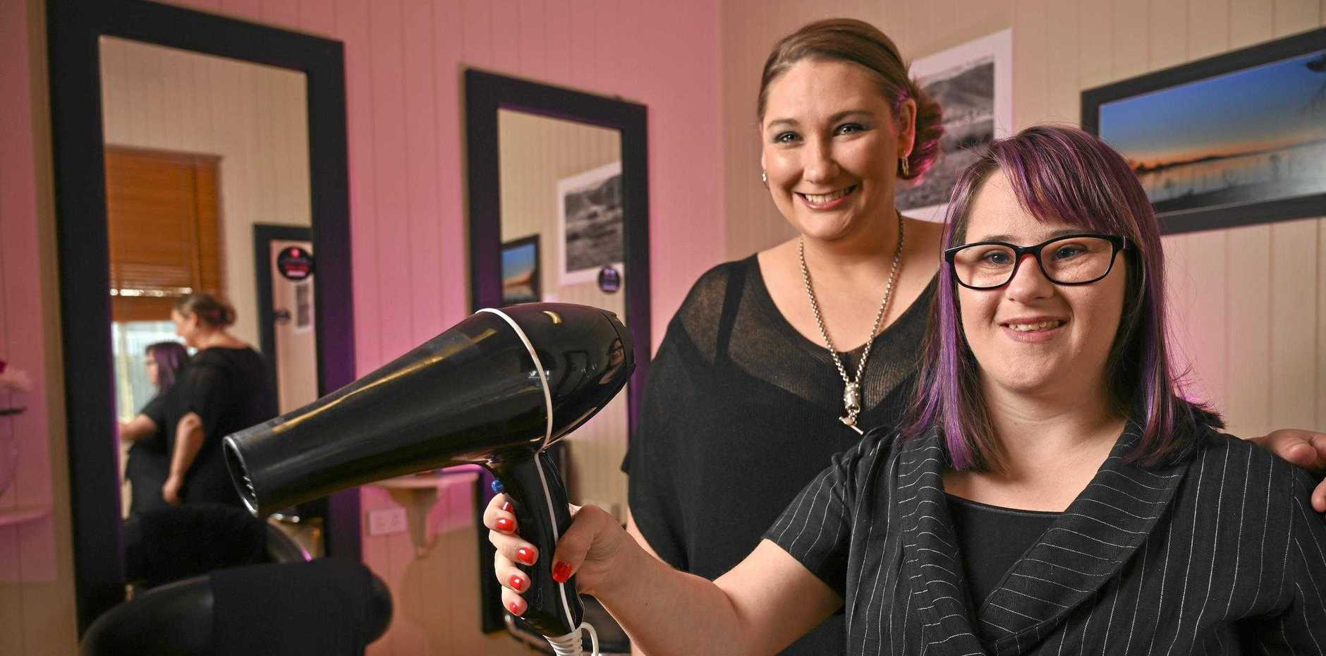 BLOWN AWAY:   Lexie Ingram, who has Down syndrome, has found her dream job   at a hairdressing salon owned by Shelley Gehrke.