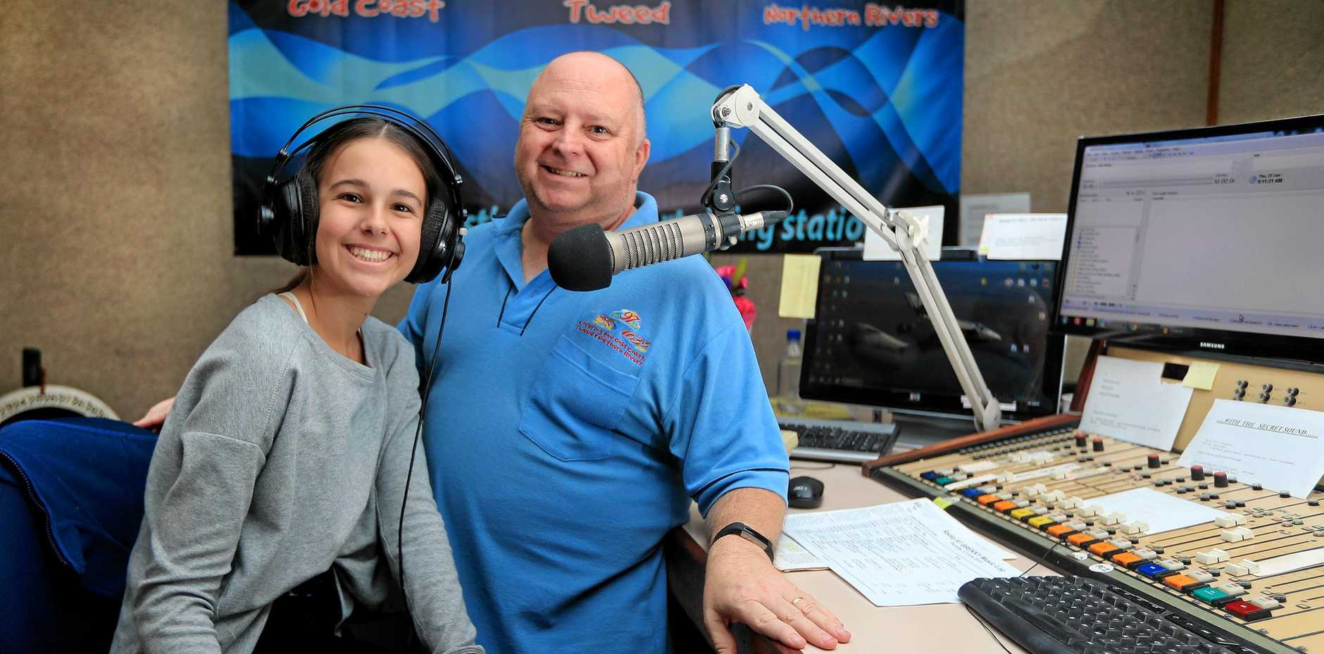 Radio 97 breakfast announcer Scott Mayman with work experience student Amy Van den Akker in the studio.