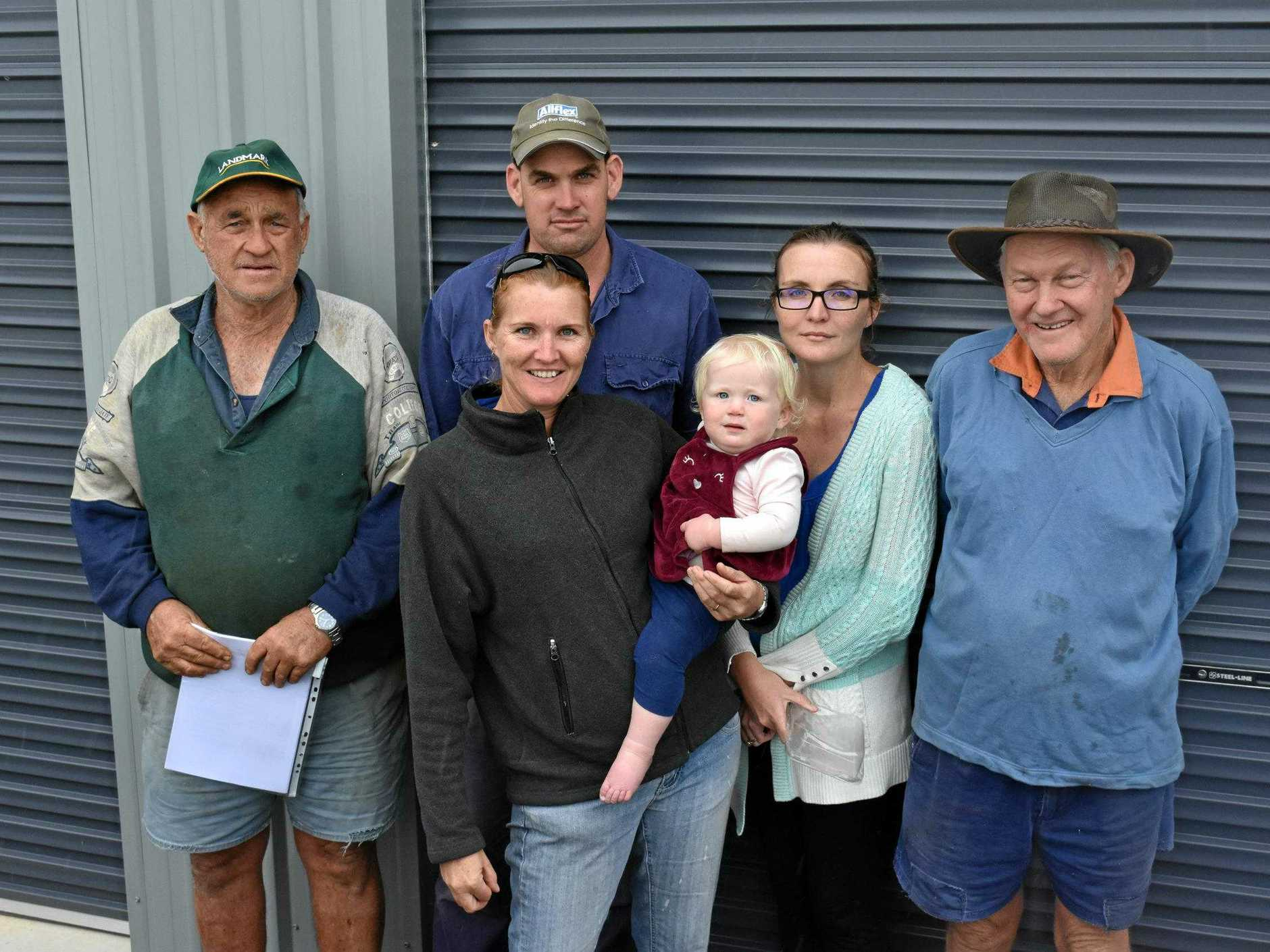 FRIGHT: Farmers have suffered enough from the trigger map debacle, according to Goomboorian and Gympie residents Peter Buchanan, Alex Long, Leanne Long (holding Georgia Wyllie), Alison Wyllie and Col Mellor.