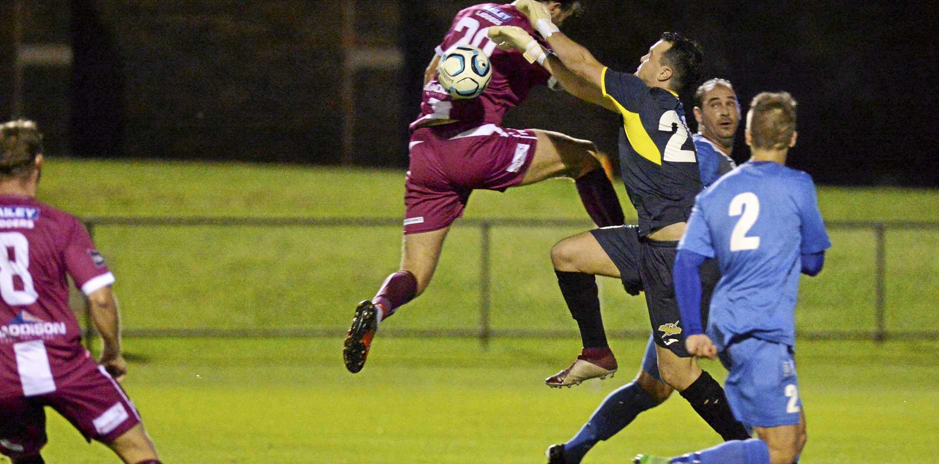 SAVE: Keeper Jace Hudson clears the ball away during the South West Queensland Thunder's FFA Cup clash with Logan Lightning.