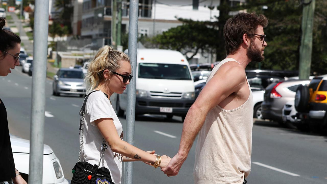 Pap - Celebrities Miley Cyrus and Liam Hemsworth pictured leaving Rick Shores restaurant in Burleigh Heads on the Gold Coast. Picture: NIGEL HALLETT
