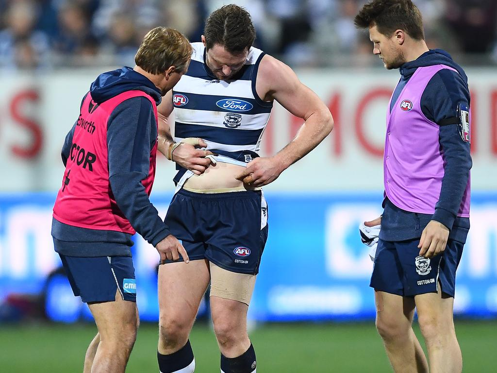 Patrick Dangerfield is seen by the doctor after his collision.