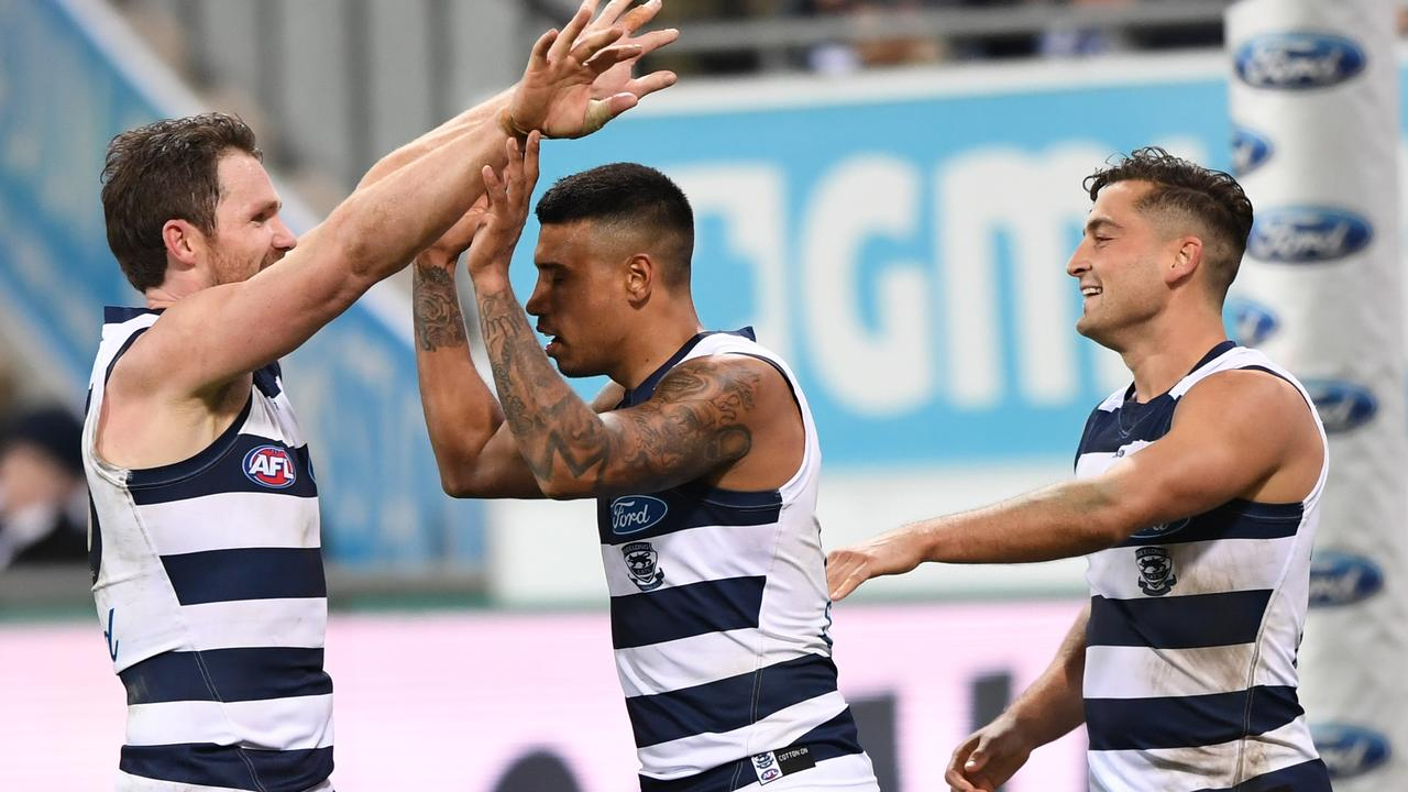 Geelong's Patrick Dangerfield celebrates with Tim Kelly and Luke Dahlhaus.