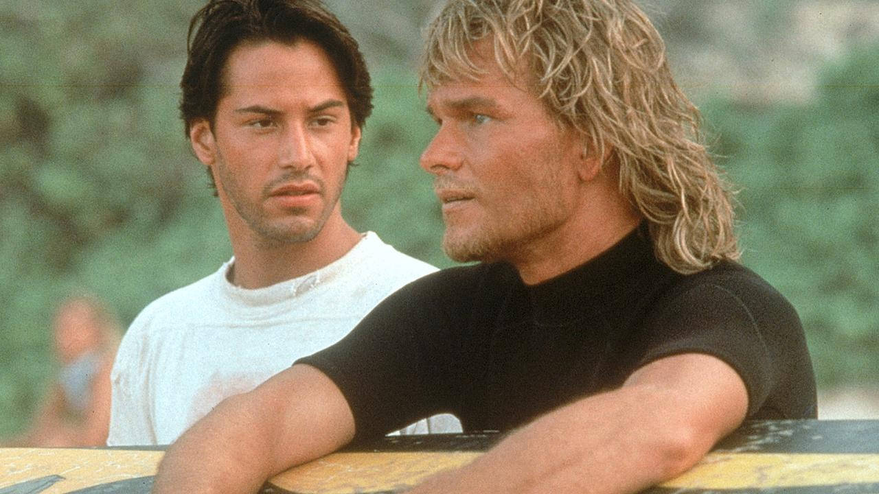 Actors Keanu Reeves (L) and Patrick Swayze in a scene from the 1991 film 'Point Break'.
