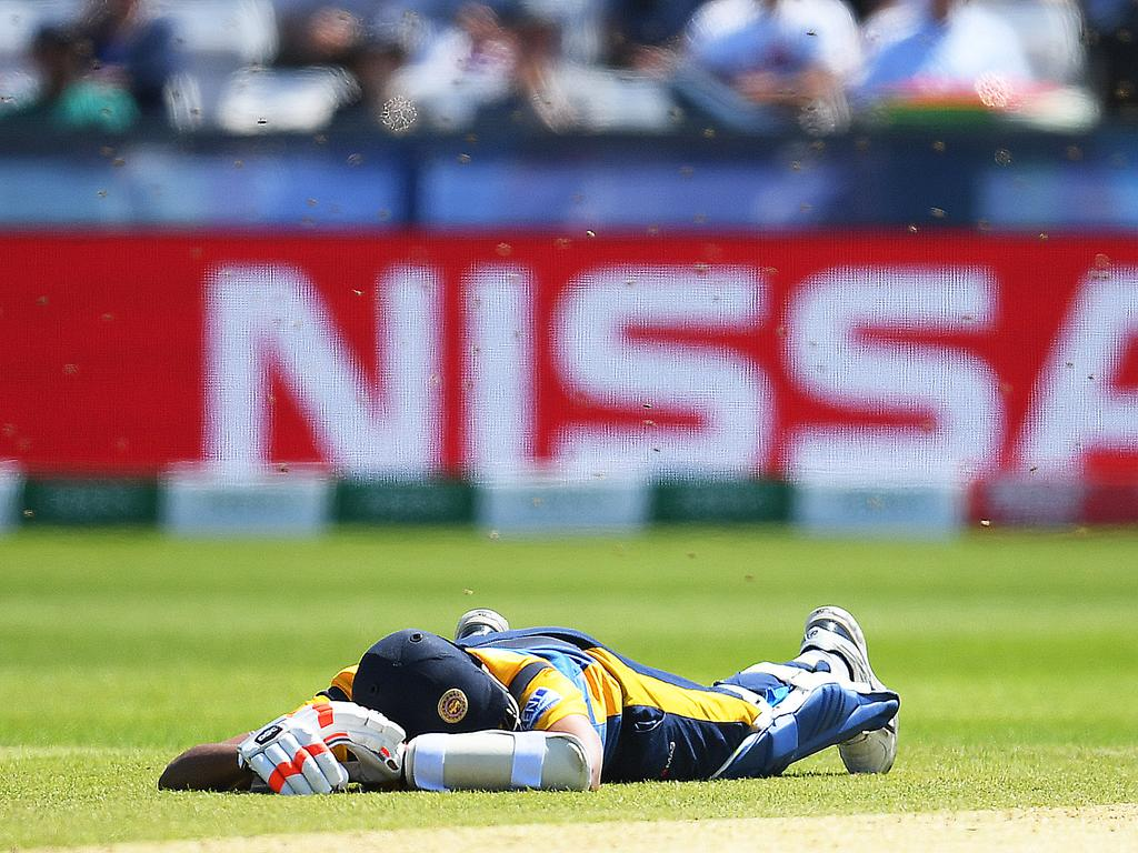 Suranga Lakmal tastes the turf. Picture: Clive Mason/Getty Images