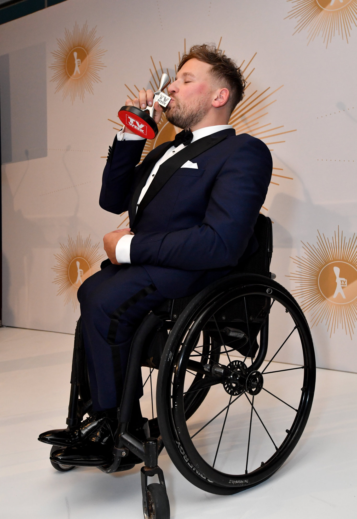 Dylan Alcott is seen kissing the Logie after winning the Graham Kennedy award for most popular new talent during the 2019 Logie Awards at The Star Casino on the Gold Coast, Sunday, June 30, 2019.