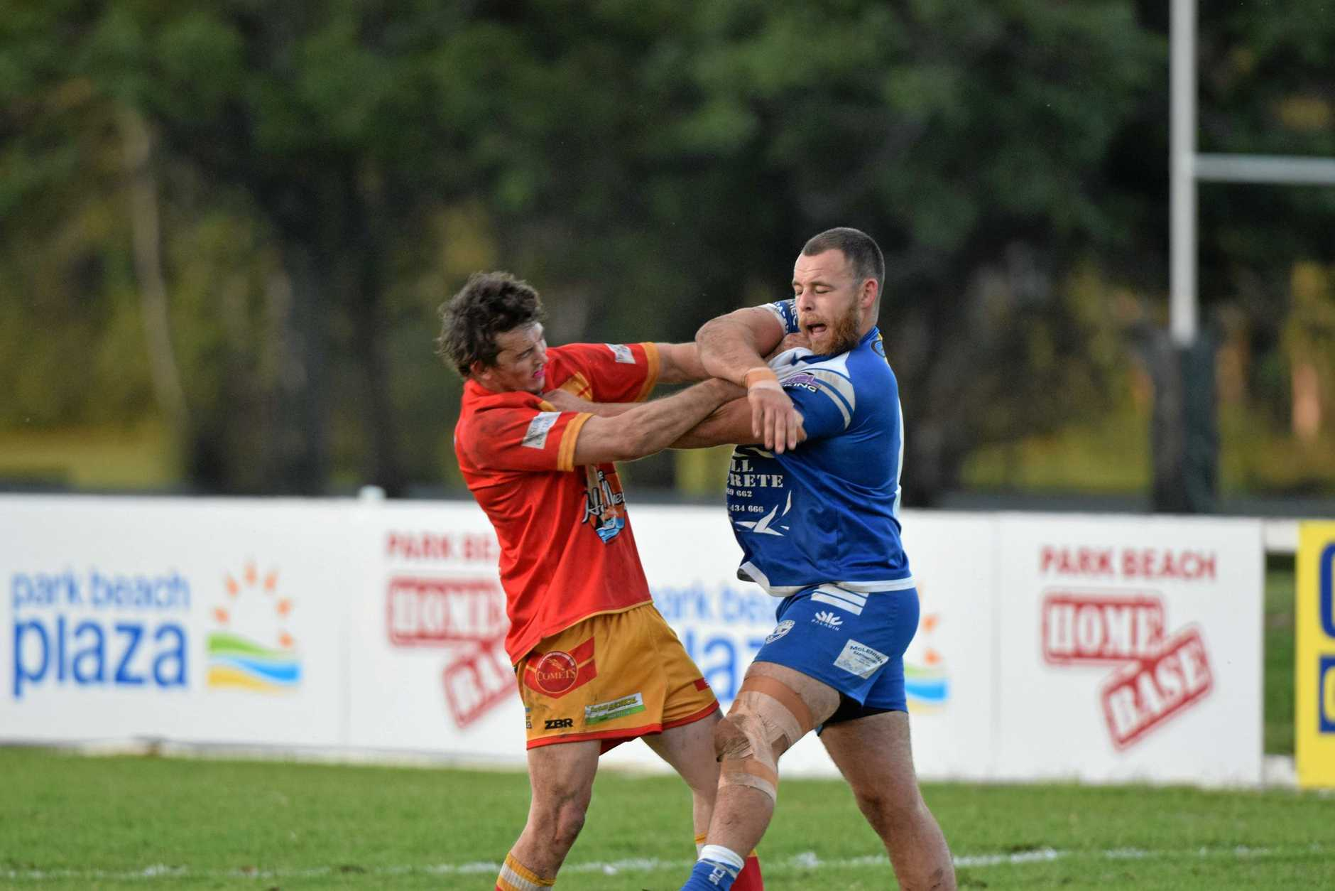 Comets fullback Nathan Curry and Ghosts prop Daniel Lavender come together.