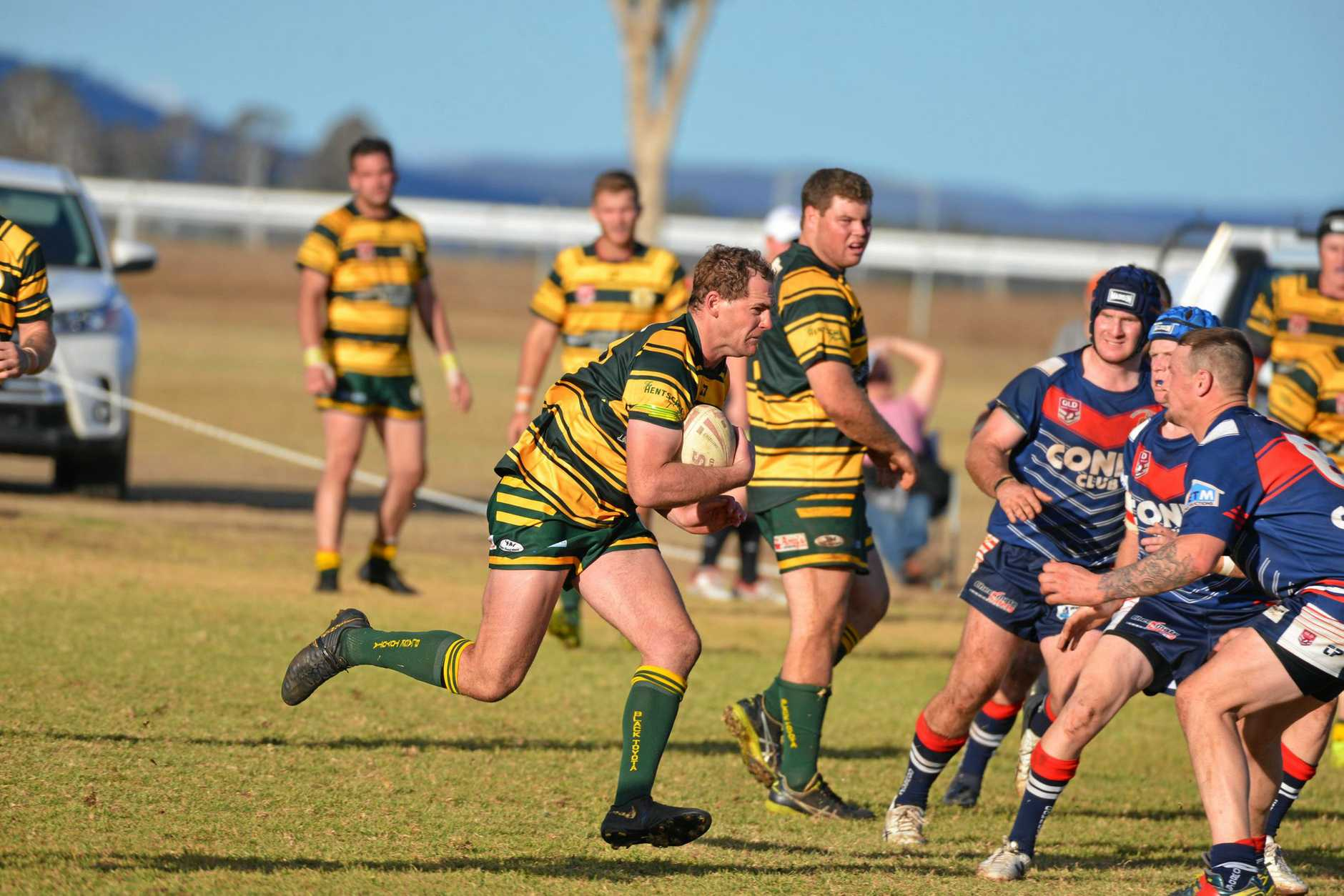 Wattles co-captain Dale Perkins runs hard in a 42-6 win against Warwick in A grade at Platz Oval.