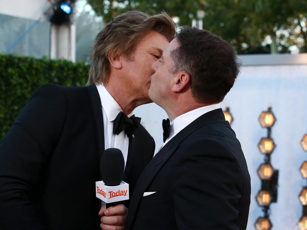Bromance ... Richard Wilkins and Karl Stefanovic kiss on the cheek. Picture: Matrix