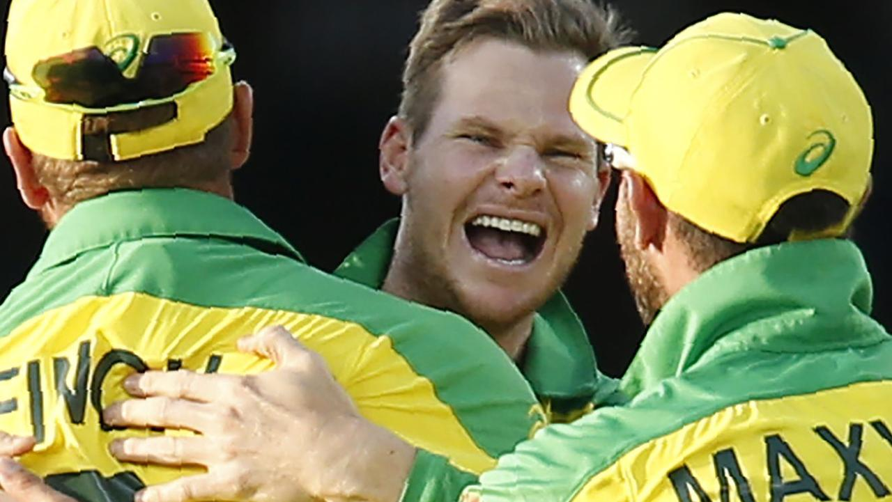 Steve Smith and the Aussies celebrate the win over New Zealand.