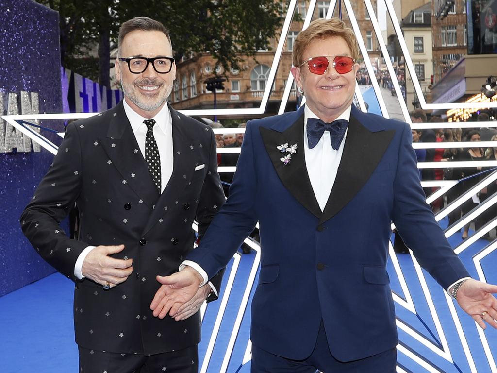 Elton John and husband producer David Furnish. Picture: AP Photo/Frank Augstein