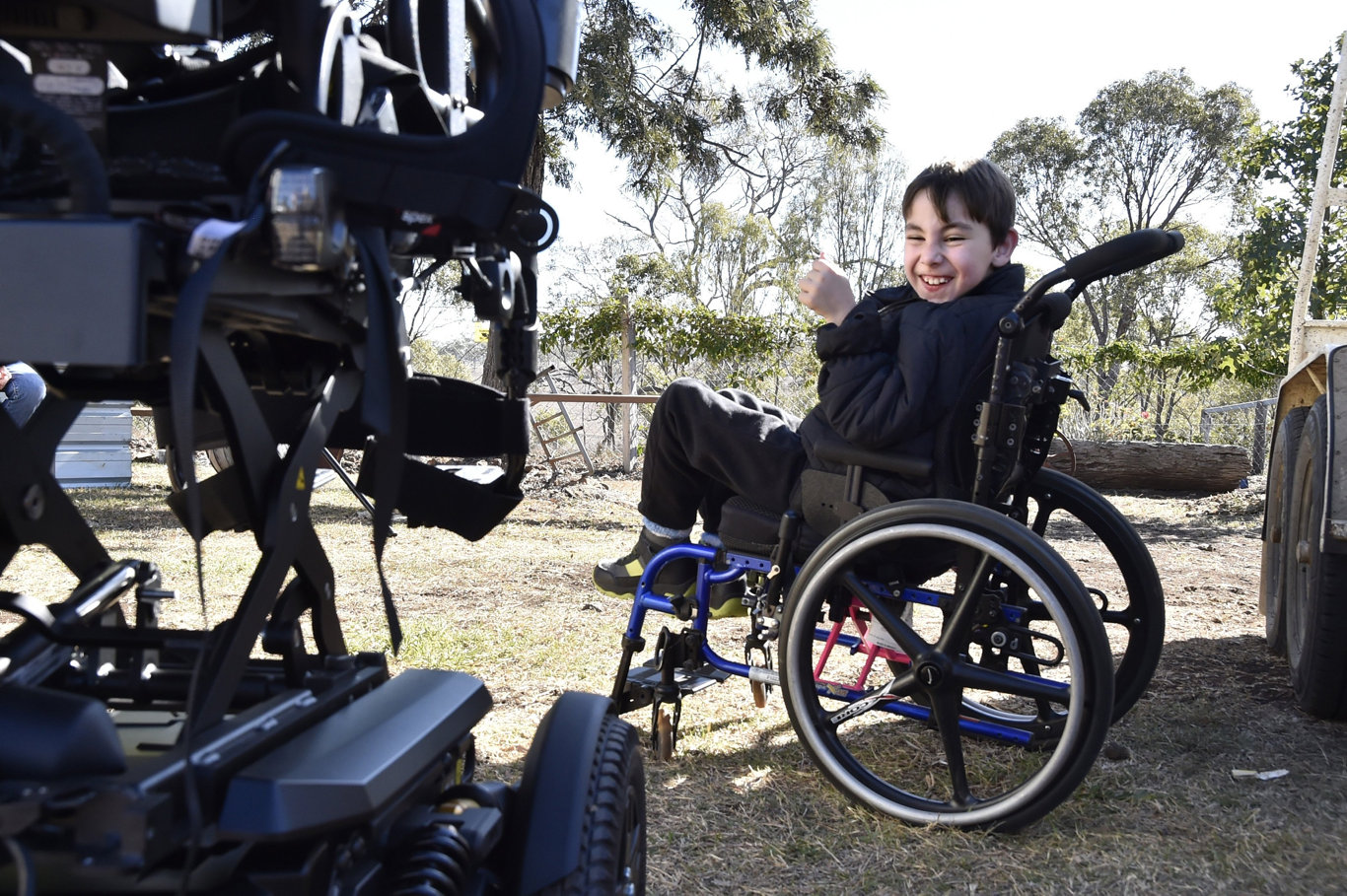 A new wheelchair has finally arrived for nine-year-old, Angus Hopkins. The long awaited delivery on Sunday will be a life changer for the boy from Nobby. An excited Angus watches on as the adjustments are made to the wheelchair. June 2019