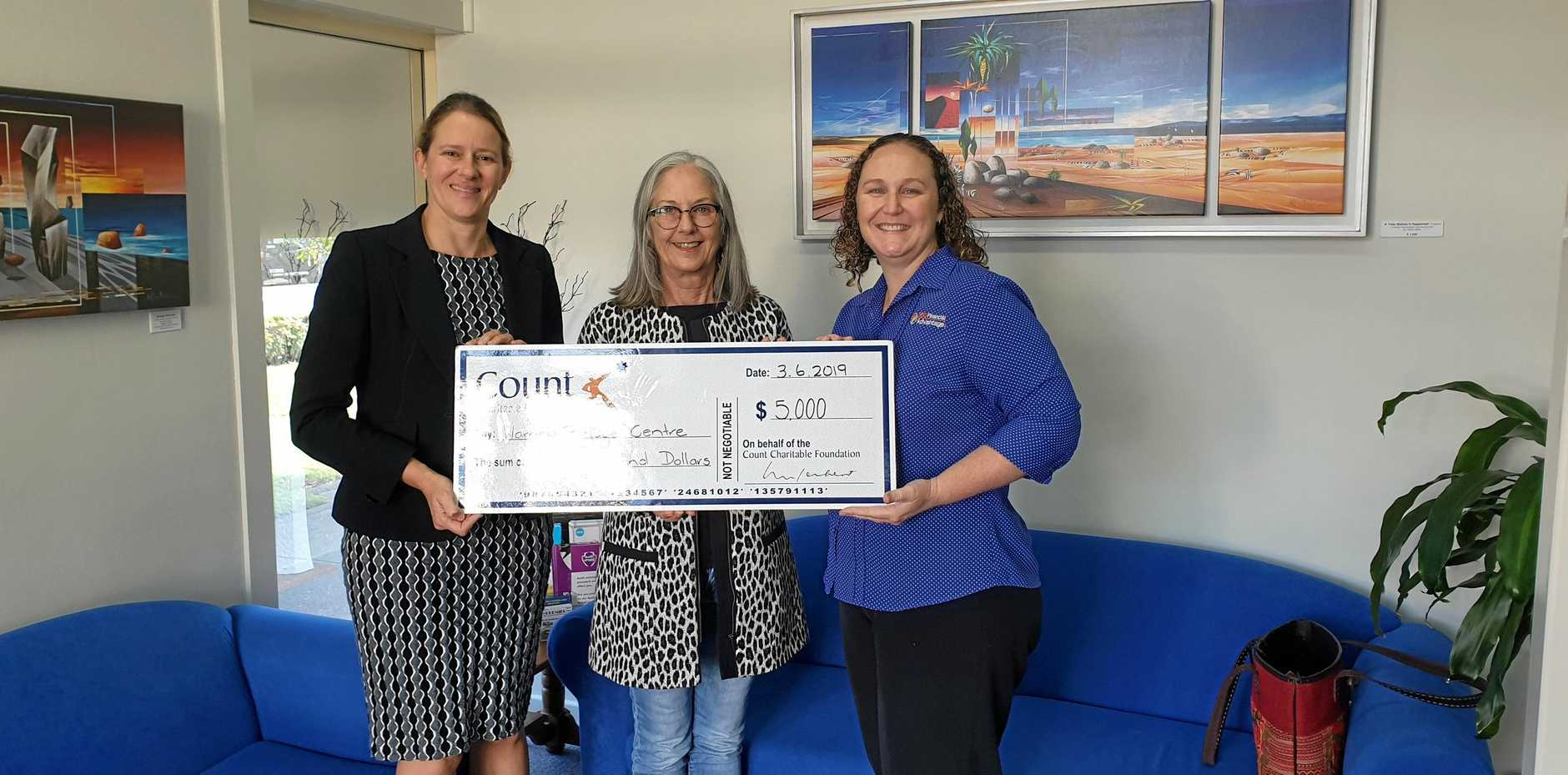 GIFT OF GIVING: Victoria Studley, Principal of 360 Financial Advantage, Charlotte Young, CEO Warrina Domestic & Family Violence Specialist Services Co-operative Ltd and Hilary Archeson Principle 360 Financial Advantage.