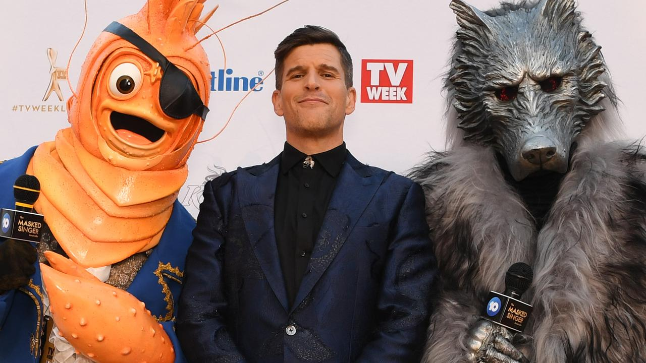 Osher Gunsberg (centre) and characters from the The Masked Singer arrive at the 2019 Logie Awards.