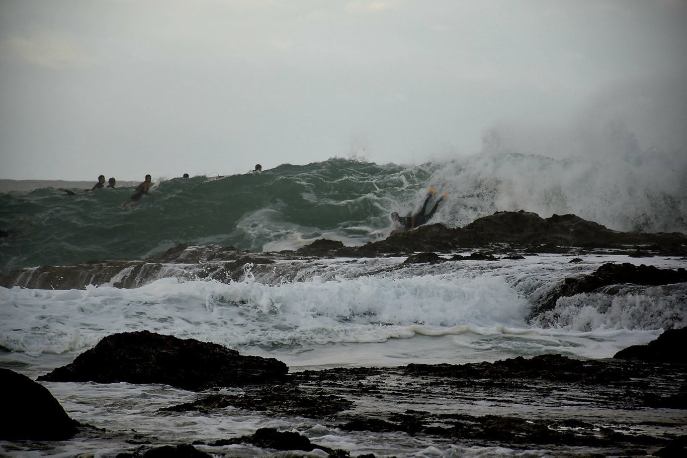 Surfers make the most of the big swell at Snapper Rocks.