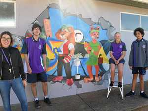 Students cheer for house mascot murals