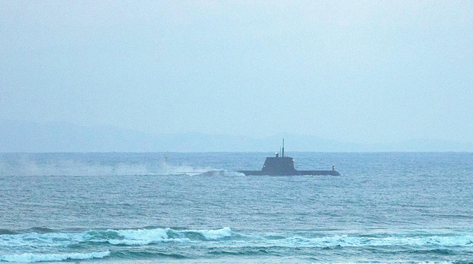 MYSTERY: A submarine was spotted by eagle-eyed Coast photographer Cade Mooney off the coastline this morning.