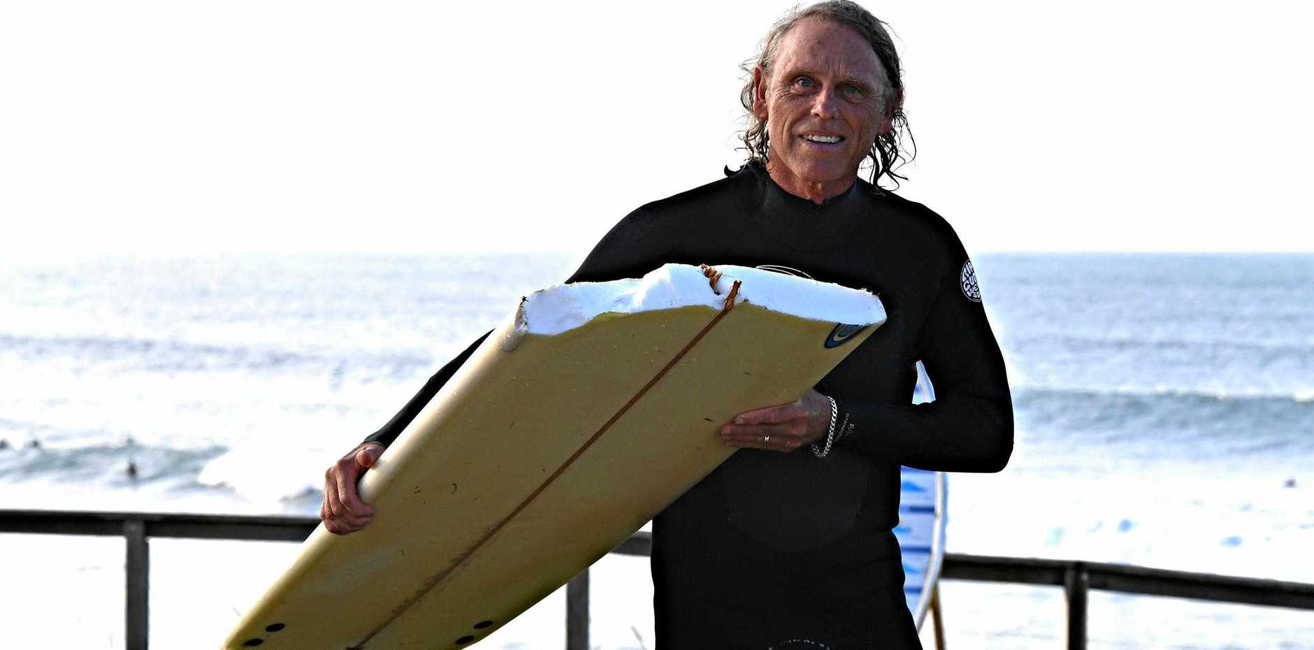 STAY SAFE: An unusually hazardous winter swell is causing havoc on Sunshine Coast beaches. Doug Polain on holiday from Western Australia broke his favourite longboard in the rough conditions.